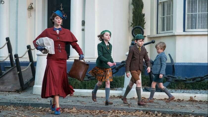 (L-R) - Emily Blunt is Mary Poppins, Pixie Davies is Annabel Banks, Nathanael Saleh is John Banks an