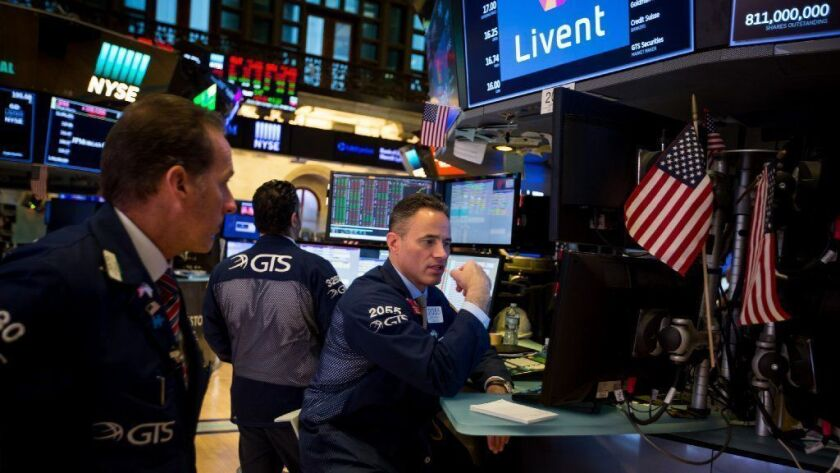 Traders work on the floor of the New York Stock Exchange in New York on Oct. 11, 2018. U.S. stocks fell, with the Dow Jones Industrial Average down more than 500 points for the day.