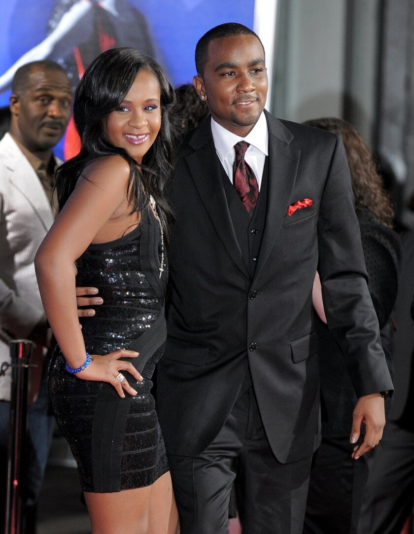 """FILE - In this Aug. 16, 2012, file photo, Bobbi Kristina Brown, left, and Nick Gordon attend the Los Angeles premiere of """"Sparkle"""" at Grauman's Chinese Theatre in Los Angeles. Messages of support were being offered Monday, Feb. 2, 2015, as people awaited word on Brown, who authorities say was found face down and unresponsive in a bathtub over the weekend in a suburban Atlanta home. (Photo by Jordan Strauss/Invision/AP, File)"""