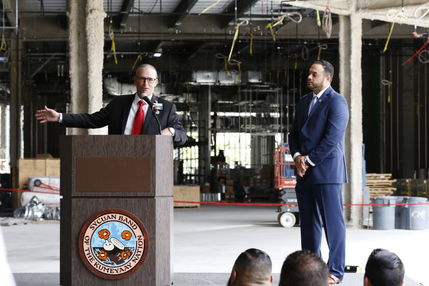 John Dinius, Sycuan's former general manager (left), spoke at a ceremonial topping off the casino's first hotel in March, 2018. To his right was Sycuan Tribal Chairman Cody Martinez.