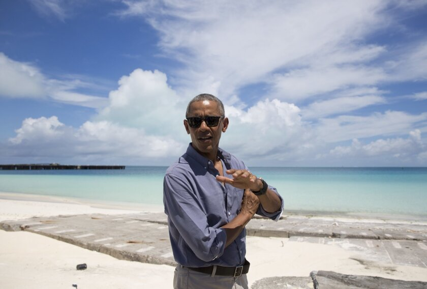 President Barack Obama speaks to media as he tours on Midway Atoll in the Papahanaumokuakea Marine National Monument, Northwestern Hawaiian Islands, Thursday, Sept. 1, 2016. (AP Photo/Carolyn Kaster)