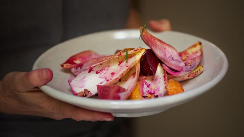 MEXICO CITY, MEXICO-- MARCH 28, 2019: Endives, beets, orange and pink pepper from Rosetta by Chef El