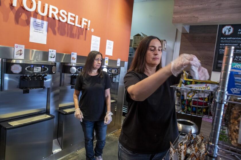Shoshana Joseph, left, and her wife, Marta Knittel, in their shop, Yogurt Stop.