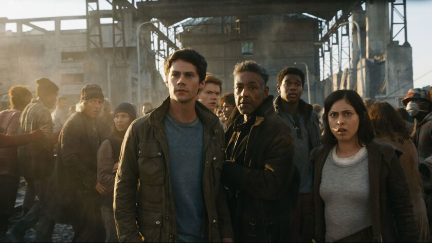 "Dylan O'Brien, left center, Thomas Brodie-Sangster, Giancarlo Esposito, Dexter Darden and Rosa Salazar star in ""Maze Runner: The Death Cure."""