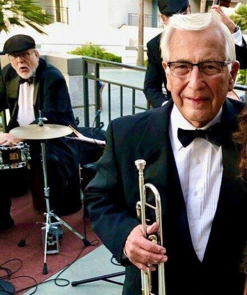 Veteran big band leader, musician Rey Vinole, right, 80, is hanging up his baton this month, but hanging on to his trumpet. He is directing his final big band concert on Jan. 19 at Dizzy's in Arias Hall behind the San Diego Musicians' Association. The drummer is Mark Serbian.