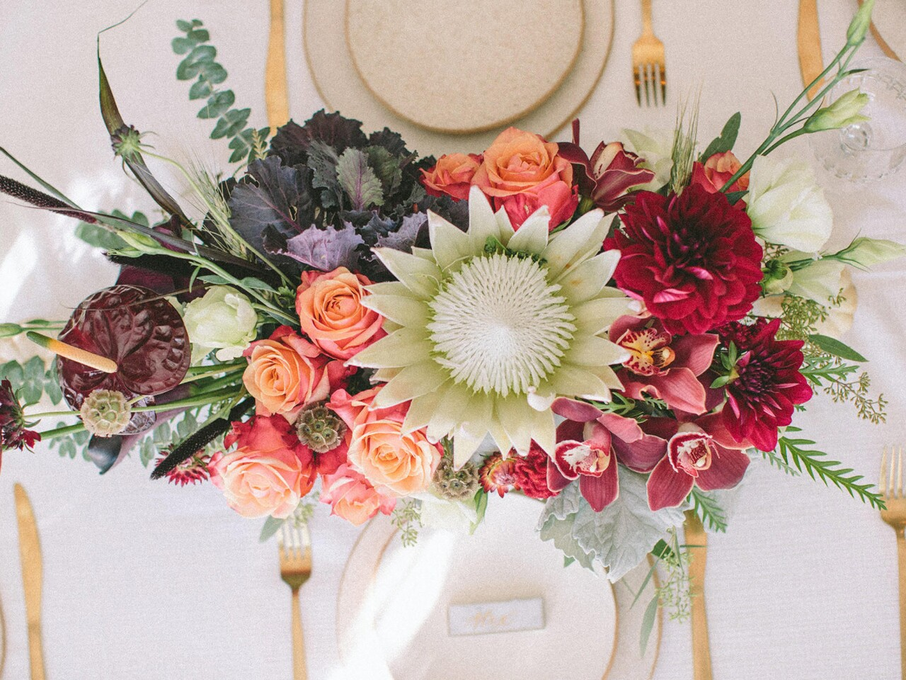 """Alexandra Scholtz, co-owner of WildFlora landscaping, gift and flower shops in Studio City and on West Third Street, enjoys presenting """"a very dense tablescape of rich colors and textures,"""" with fall fruits and handmade dishes from Corrin Ceramics."""