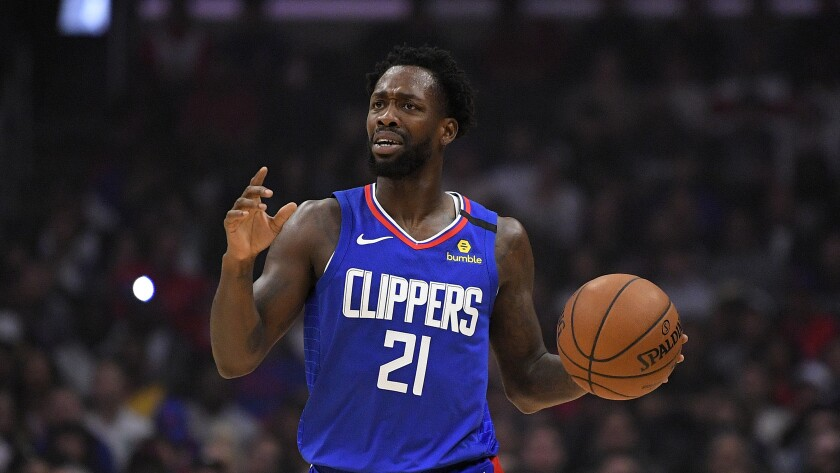 Clippers guard Patrick Beverley gestures during a game against the 76ers on March 1, 2020, in Los Angeles.
