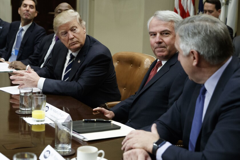 President Trump met with pharmaceutical industry leaders at the White House on Tuesday. From left are PhRMA President Stephen Ubl, Merck CEO Kenneth Frazier, Trump, Celgene CEO Robert Hugin and Amgen CEO Robert Bradway.