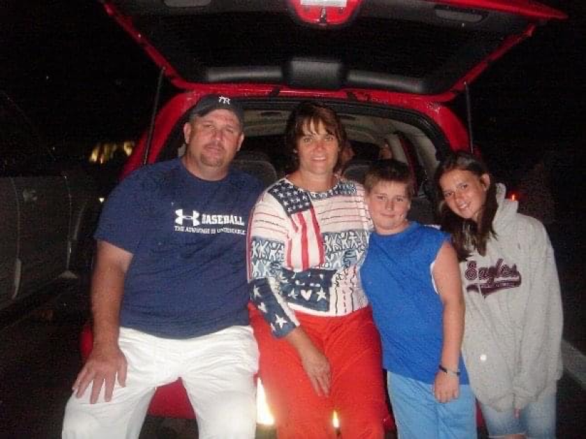 Paul Grattan Jr, second from right, is shown with his father, Paul, mother Patty and sister Caroline in the mid 2000s.
