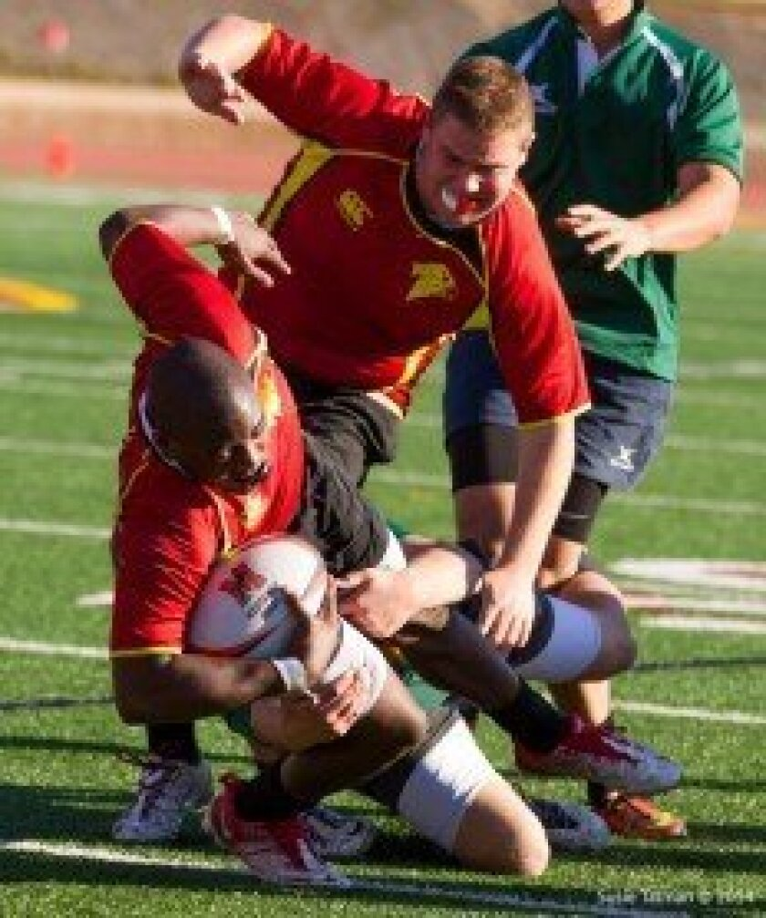 Torrey Pines Senior Flanker Dwayne Hines is tackled by LCC's Fly Half Brennan O'Connor. Photo/Susie Talman.