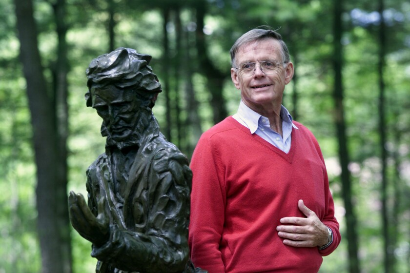 Author Robert D. Richardson stands by the statue of Henry David Thoreau at the Walden Pond Reservation.