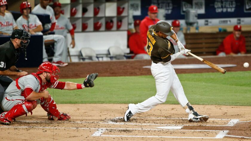 The Padres' Jose Rondon hits an RBI single against the Philadelphia Phillies during the second inning of a baseball game Friday, Aug. 5, 2016, in San Diego.