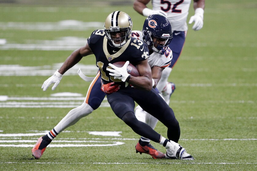 FILE - In this Sunday, Jan. 10, 2021 file photo, New Orleans Saints wide receiver Michael Thomas (13) carries against Chicago Bears cornerback Kindle Vildor (22) in the first half of an NFL wild-card playoff football game in New Orleans. Saints coach Sean Payton says Michael Thomas' ankle surgery should have been performed earlier than in June and apparently will force the Saints to play some games without the star receiver. But Payton is declining to assign blame for delays in Thomas' return to the field. Payton spoke Wednesday July 28, 2021 during his traditional interview session on the eve of the first practice of training camp.(AP Photo/Butch Dill, File)