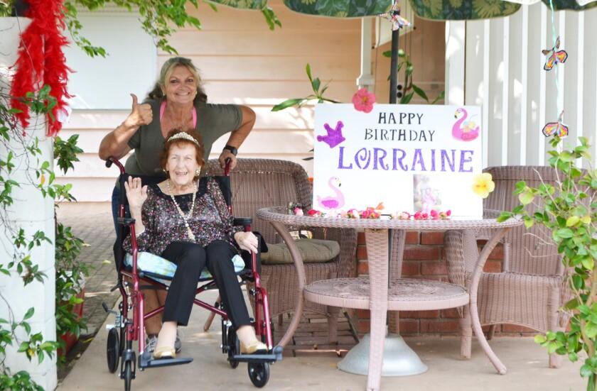 Lorraine Whalen, with friend Barbara Jogoleff, at her 101st birthday parade.