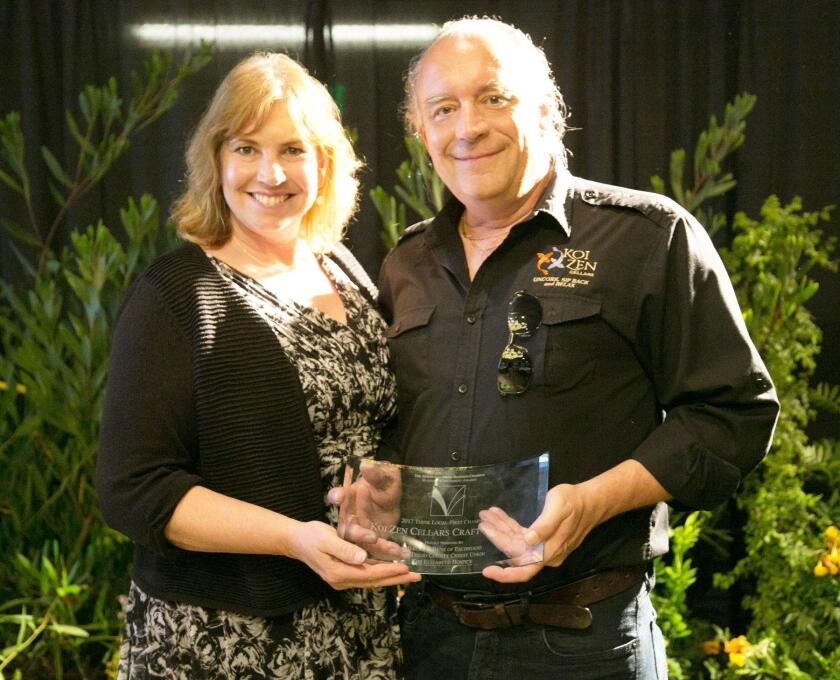 Lisa and Darius Miller of Koi Zen Cellars Craft Winery, the Think Local First Champion of the Year.