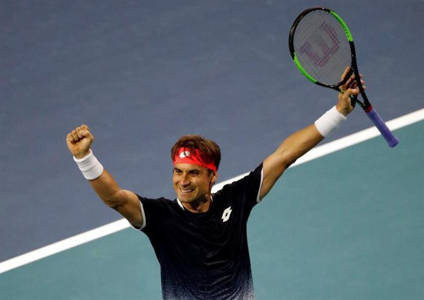 El tenista español David Ferrer celebra tras vencer al alemán Alexander Zverev en un partido del Abierto de Miami. EFE