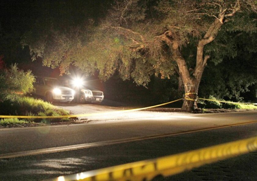 Authorities gathered Sunday night at the site of the discovery of Amber Dubois' remains, about three miles north of the Pala Mission.