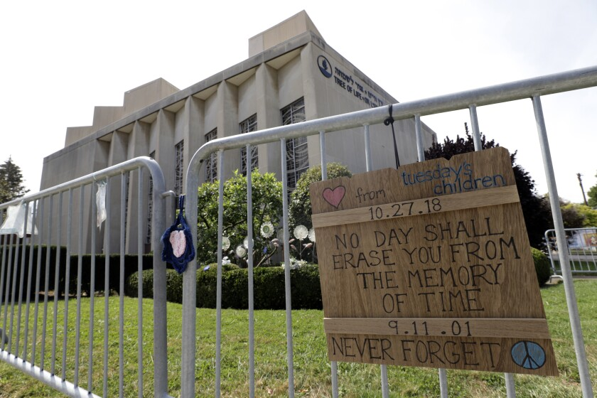 A sign hangs on a fence surrounding the Tree of Life synagogue in Pittsburgh on Tuesday, Sept. 17, 2019. The first anniversary of the shooting at the synagogue, that killed 11 worshippers, is Oct., 27, 2019. Authorities charged Robert Bowers, 47, a truck driver from Baldwin, Pennsylvania, in the attack that killed eight men and three women, and wounded seven others inside Tree of Life synagogue, where congregants from New Light and Dor Hadash also had gathered. Bowers has pleaded not guilty . He faces the death penalty if convicted. (AP Photo/Gene J. Puskar)