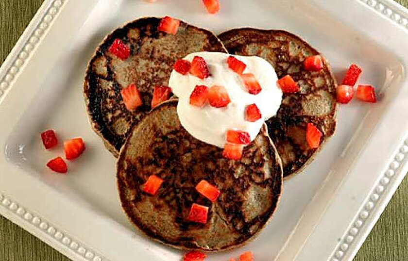 TRADITION: Russian blinis are made with buckwheat flour, and are similar to crepes.
