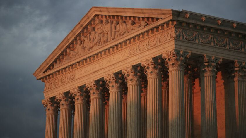 In this Oct. 4, 2018 photo, the U.S. Supreme Court is seen at sunset in Washington. The Supreme Co