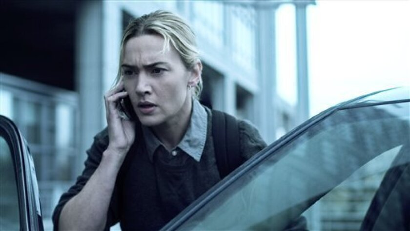 "In this image released by Warner Bros. Pictures, Kate Winslet is shown in a scene from the film ""Contagion."" (AP Photo/Warner Bros. Pictures)"