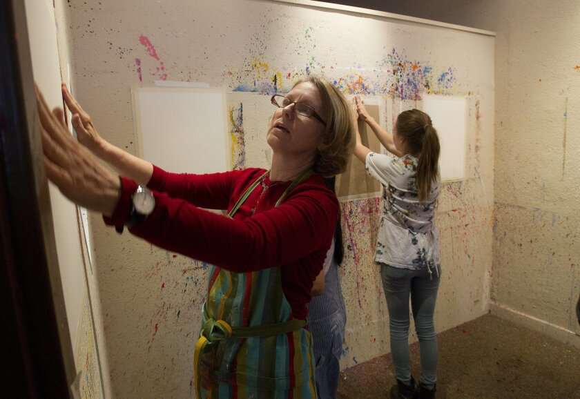 Tish Sjoberg (left) prepared the painting room for an evening of Art Aerobics at her Expressive Arts studio in North Park.