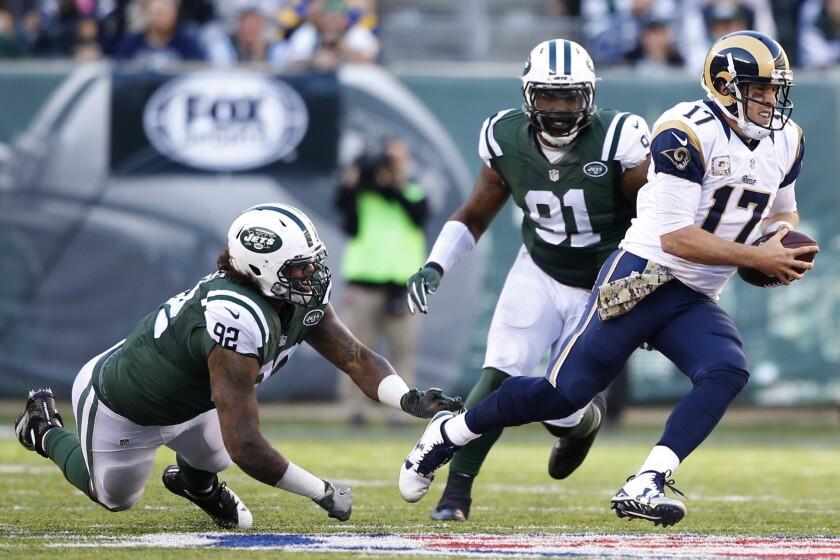 Rams quarterback Case Keenum scrambles from pressure of Jets defensive lineman Leonard Williams during the third quarter.