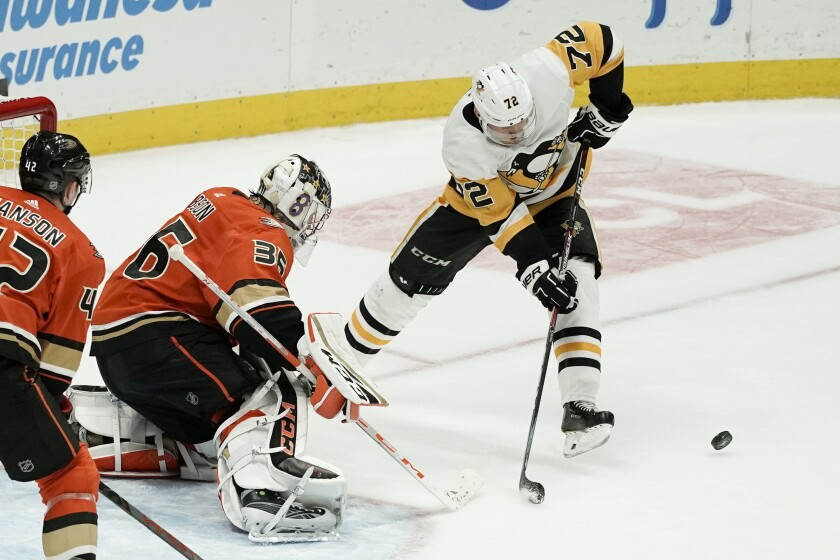 Ducks goalie John Gibson blocks a shot by Penguins wing Patric Hornqvist during the third period Friday night.