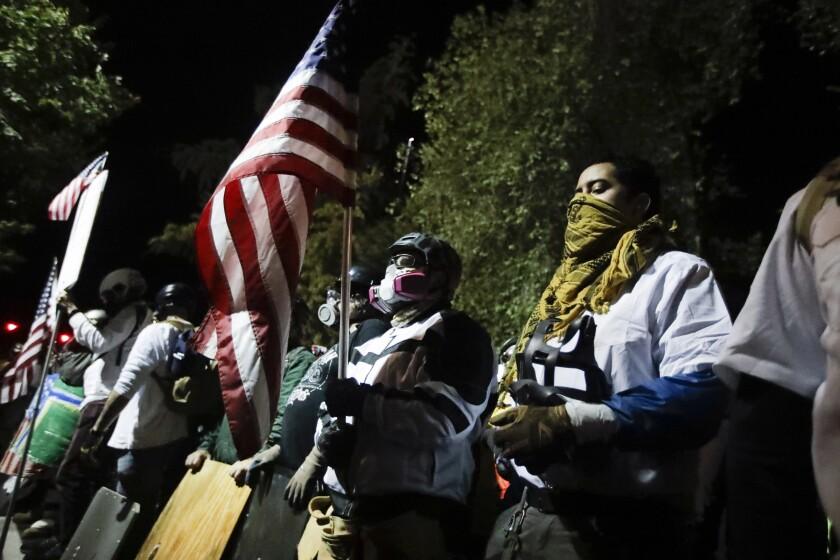 Veteranos militares participan en una protesta del movimiento Black Lives Matter