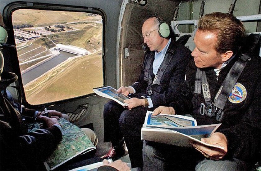 Interior Secretary Ken Salazar (left) and Gov. Arnold Schwarzenegger took a helicopter tour of the Sacramento-San Joaquin River  Delta yesterday. Salazar pledged to work with state officials on California's water issues. (Robert Durell / Associated Press)