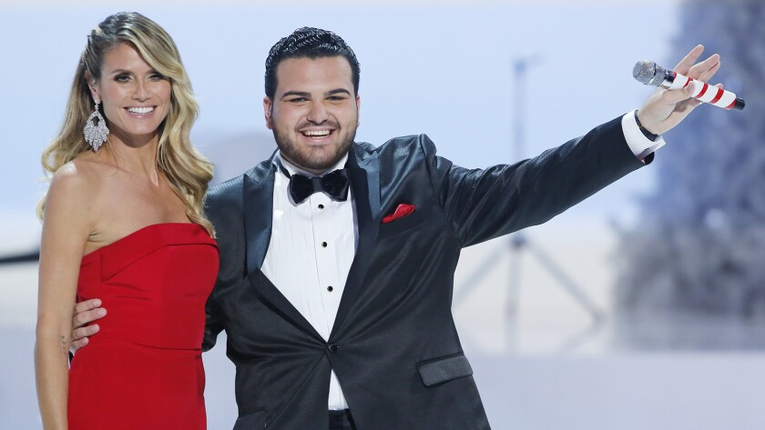 """Heidi Klum and former contestant Sal Valentinetti in """"America's Got Talent: A Holiday of Champions"""" on NBC."""