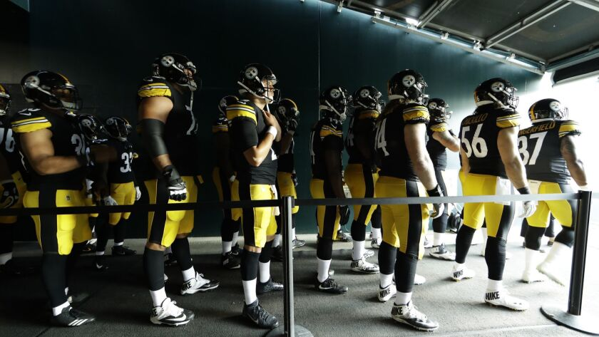 Pittsburgh Steelers wait in the tunnel before the start of a preseason NFL football game against the