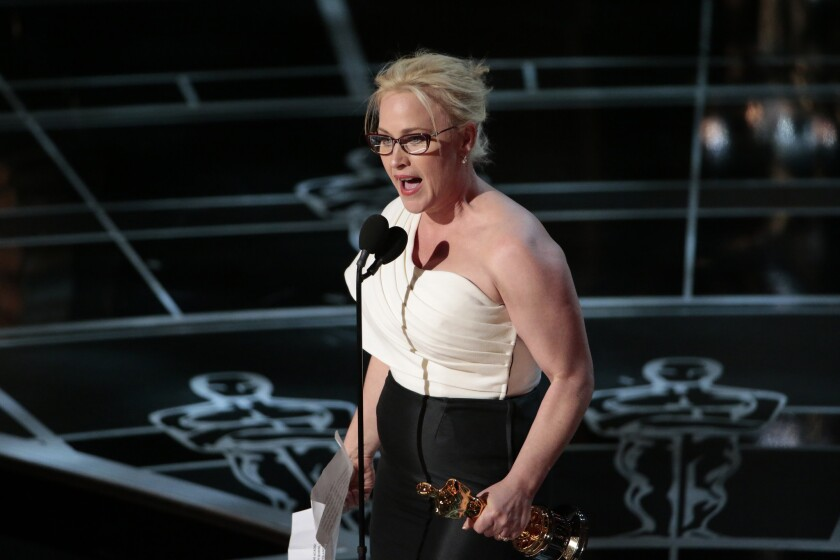 """Patricia Arquette gives her speech after winning the supporting actress Oscar last year for """"Boyhood."""" This year's ceremony will included a new feature: a text scroll that will appear under winners as they speak."""