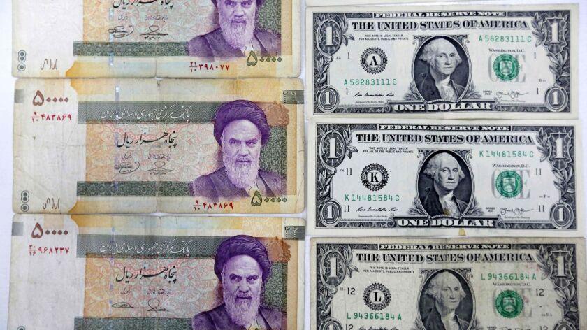 FILES-IRAN-POLITICS-CURRENCY