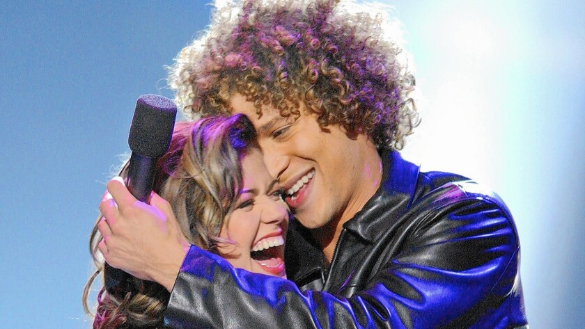 """Kelly Clarkson embraces fellow """"American Idol"""" competitor Justin Guarini after being crowned the first winner."""
