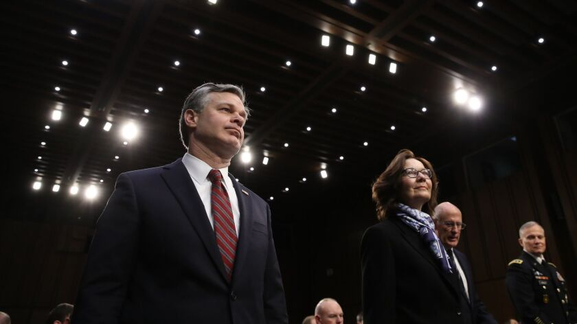 FBI Director Christopher Wray, left, CIA Director Gina Haspel and National Intelligence Director Dan Coats, second from right, appear before the Senate Intelligence Committee on Tuesday.