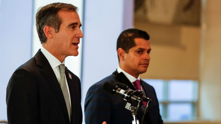 Los Angeles Mayor Eric Garcetti and Assemblyman Miguel Santiago on skid row Monday.