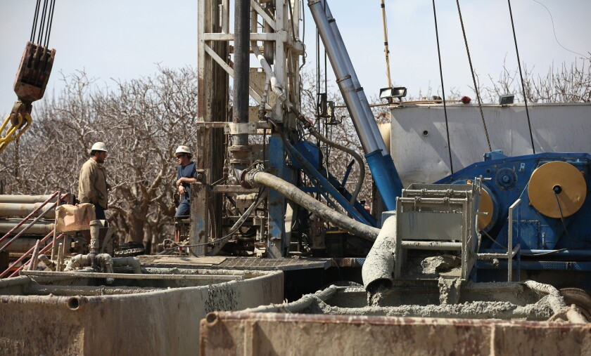Fluids from the fracking process flow into containment tanks at a oil well near Bakersfield. A new EPA study says that hydraulic fracturing poses risks for drinking water but that the harm is limited. Doubts remain about how comprehensive the study is, however.