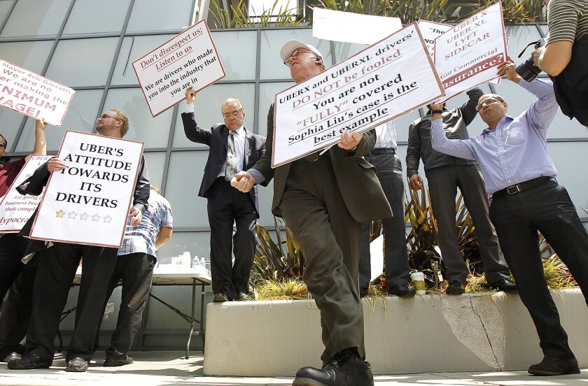 Uber drivers in Santa Monica protesting their treatment by the firm last year.