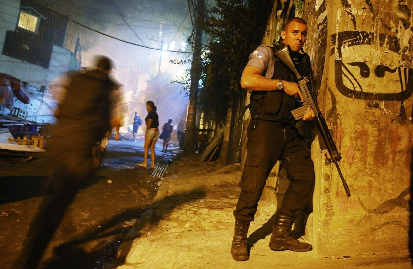 Brazilian police patrol Tuesday night after an operation in the Pavao-Pavaozinho favela, just blocks from Rio de Janeiro's Copacabana Beach, ended in the death of a TV dancer, sparking further street violence.