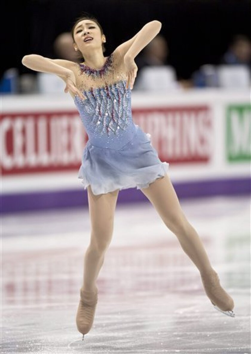 Kim Yu-na, from South Korea, performs during the ladies short program at the World Figure Skating Championships Thursday, March 14, 2013, in London, Ontario. (AP Photo/The Canadian Press, Paul Chiasson)