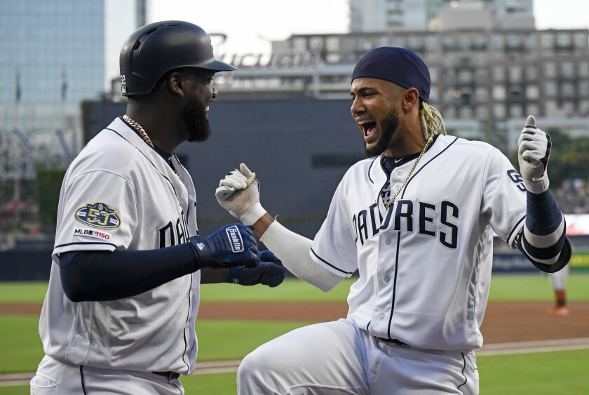 The Padres' Franmil Reyes (32) is congratulated by Fernando Tatis Jr. after hitting a home run during the first inning of a baseball game against the Baltimore Orioles, Monday, July 29, 2019, in San Diego.