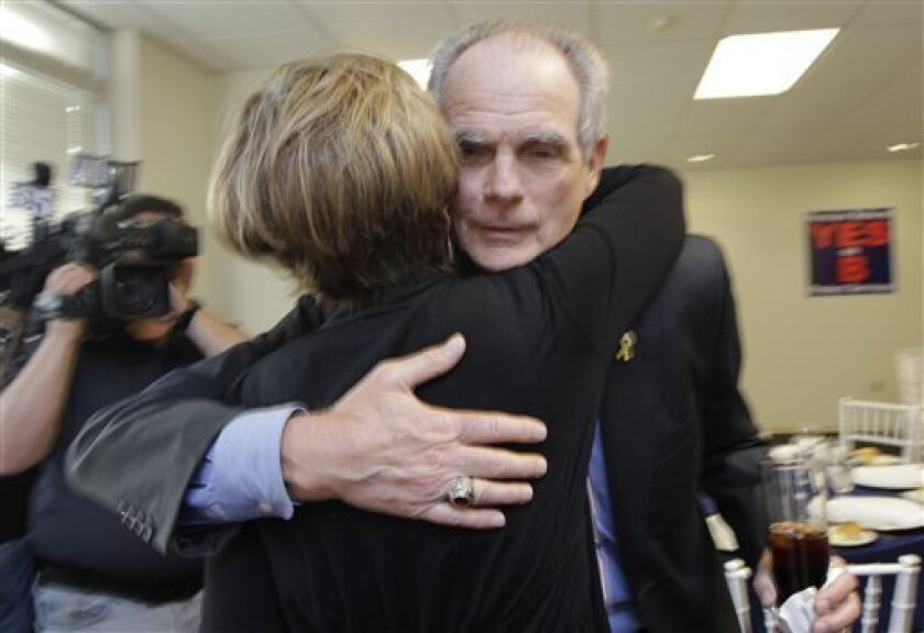 San Jose Mayor Chuck Reed, right, hugs former San Jose Vice Mayor Pat Dando at a campaign party in San Jose, Calif., Tuesday, June 5, 2012.  As state and local governments across the country struggle with ballooning pension obligations, voters in two major California cities cast ballots Tuesday on