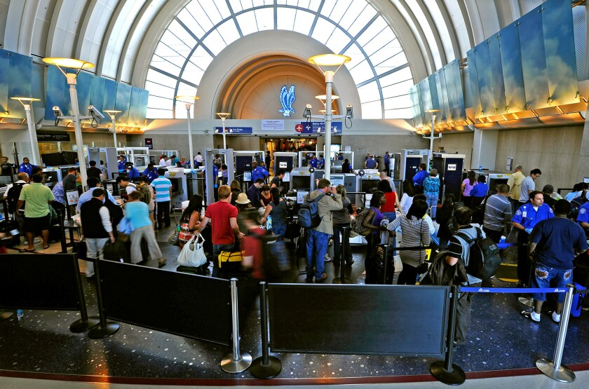 Passengers wait to pass through TSA security at LAX.