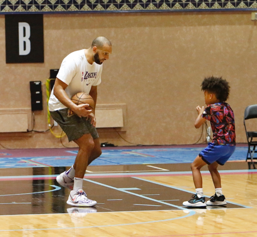 Jared Dudley shares some basketball tips with his son, Juju.