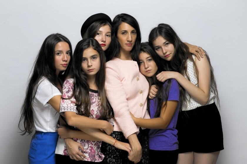"Director and writer Deniz Gamze Ergüven, center, and the cast of ""Mustang,"" France's submission to the foreign-language film Oscar competition: Elit Iscan, left, Günes Sensoy, Ilayda Akdogan, Doga Zeynep Doguslu and Tugba Sunguroglu."