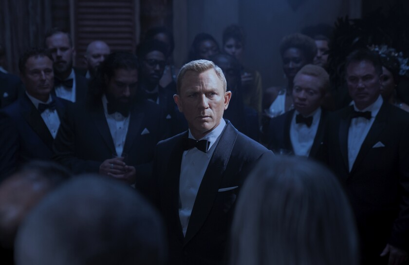 """This image released by Metro Goldwyn Mayer Pictures shows Daniel Craig in a scene from """"No Time To Die."""" (Nicola Dove/Metro Goldwyn Mayer Pictures via AP)"""