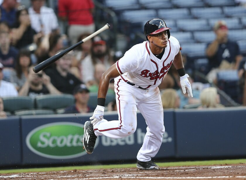 FILE - In this Tuesday, Sept. 1, 2015, file photo, Atlanta Braves' Hector Olivera, of Cuba, runs to first as he grounds out in his first Major League at bat in the second inning of a baseball game against the Miami Marlins in Atlanta. The Braves have pinned much of their offensive hopes on Olivera,