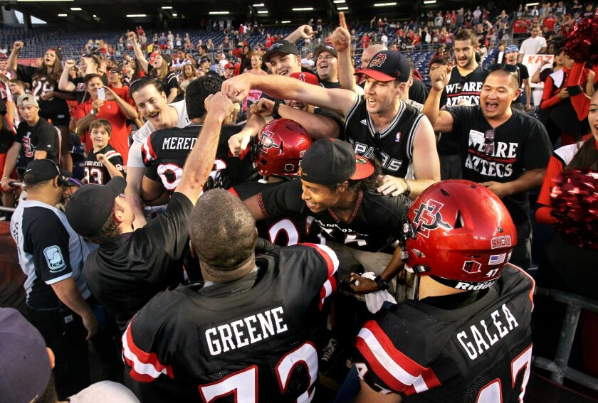 Aztecs players celebrate their victory with their fans.