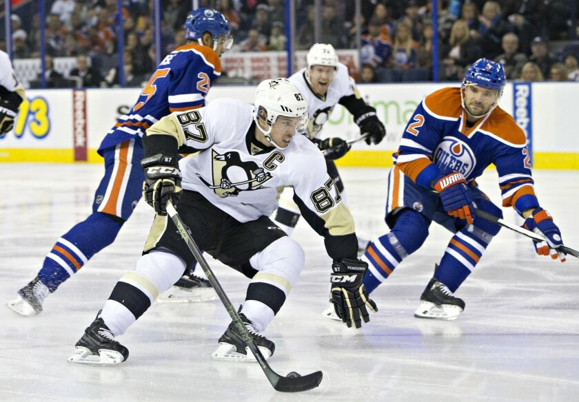 Pittsburgh Penguins' Sidney Crosby (87) is chased by Edmonton Oilers' Darnell Nurse (25) and Andrej Sekera (2) during the first period of an NHL hockey game Friday, Nov. 6, 2015, in Edmonton, Alberta. (Jason Franson/The Canadian Press via AP)